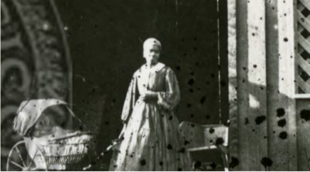 Zoomed in portion of the Boynton photo from title page, showing woman and baby carriage, University of Mississippi, (circa 1860): UM Special Collections